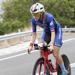 Sarah Piampiano climbing hill on bike