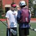 Lacrosse Head Coach Frank Clark with camp participant Connor Simpson of Eagan, Minn. on UMD's Griggs Field.