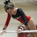 Hinsdale Central's Lindsey Riker competes on the uneven parallel bars
