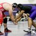 Niles North's James Edmond competes against Niles West's Rafael Awad