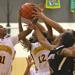 Marshall's Tiara Roberts (12) gets control of a rebound