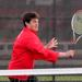 Niles West's Jesse Sacks hits a volley