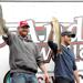 Mike Winkler (left) and Sean Moran hold up their two largest walleyes Saturday during the weigh-in ceremony at the 14th annual Kraus-Anderson Walleye Classic. (Malachi Petersen | Bemidji Pioneer)