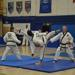 martial arts black belts competing at a taekwondo tournament