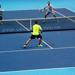 Two teams competing against in eachother in doubles tennis.