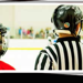 ringette canada's logo with picture of ref