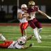 Lakeville South running back Carson Hansen (28) leaps over Lakeville North linebacker Noah Nephew (24) on his way to a 75 yard touchdown run during the second quarter of high school football game at Lakeville South High School in Lakeville on Friday, Oct.
