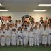 Students in a karate school doing karate lessons in Denver, CO