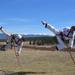 Adult martial artists kickingin an adult martial arts program