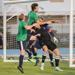 Tucker Hume battling against two Energy FC players in front of OKC's goal