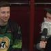 Ryan Williams and Shane McEleney sitting in Fury FC locker room wearing St Patick's Day attire