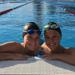 Grace and Molly Kowal in pool after 800 freestyle race at U.S Open Swimming Championships.