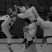 Black belt breaking a board in taekwondo and karate lessons