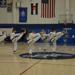 Some martial arts black belts practicing a taekwondo poomse together
