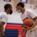 Two basketball players speak to each other