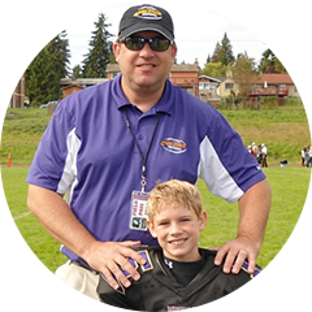 Chris Sauter poses with a player from the Lake Stevens Youth Football team.