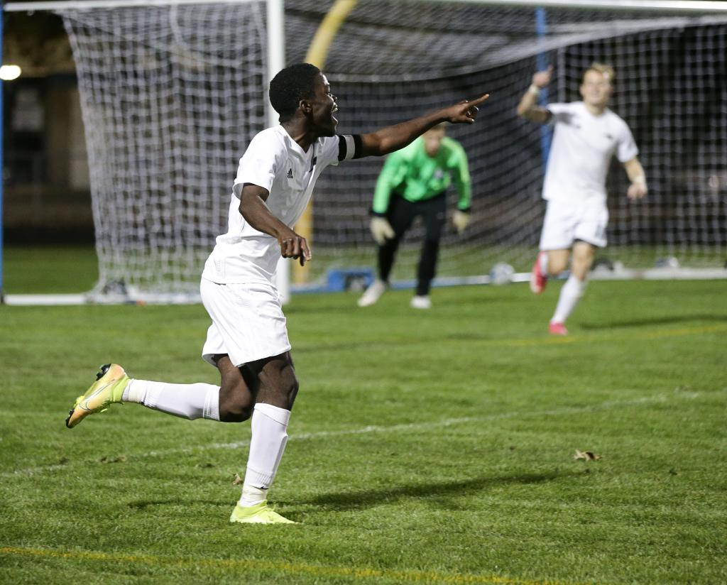 Leo Conneh looks for his teammates to celebrate a second-half goal. Conneh's two goals helped Champlin Park outscore Blaine 6-1 in the final regular-season matchup for both teams. Photo by Cheryl A. Myers, SportsEngine