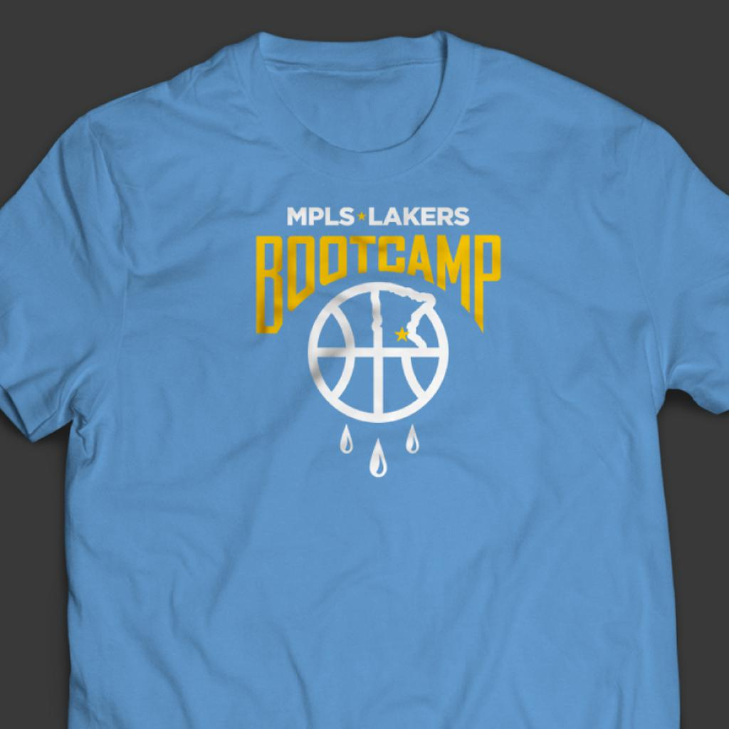 """The official 2021 Mpls Lakers Boot Camp T-Shirt in Columbia Blue features a graphic with curved """"Boot Camp"""" text, a basketball underneath it with droplets of sweat dripping off the bottom of the ball"""