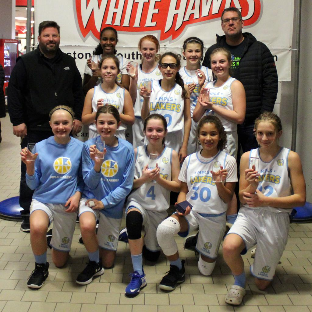 Minneapolis Lakers Girls 7th Grade Gold pose with their hardware after taking 2nd Place at Westonka White Hawk Classic