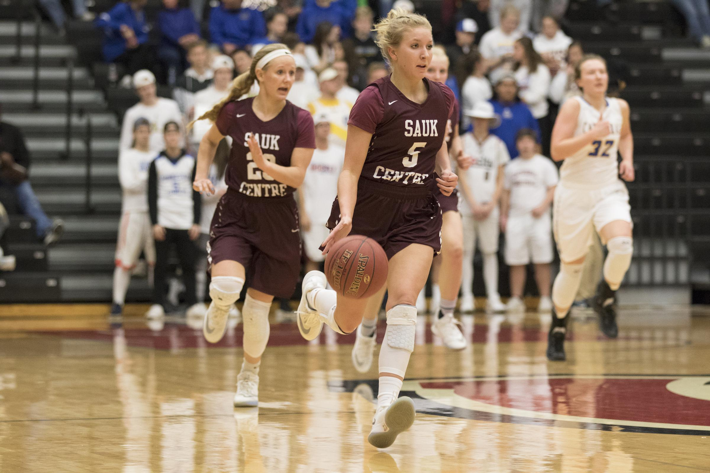 Kelsey Peschel (right) and Maesyn Thiesen (left) in their section final on March 9. They were named two of the Mainstreeters' three all-tournament selections after beating Roseau to win the Class 2A state championship. Photo by Jeff Lawler, SportsEngine