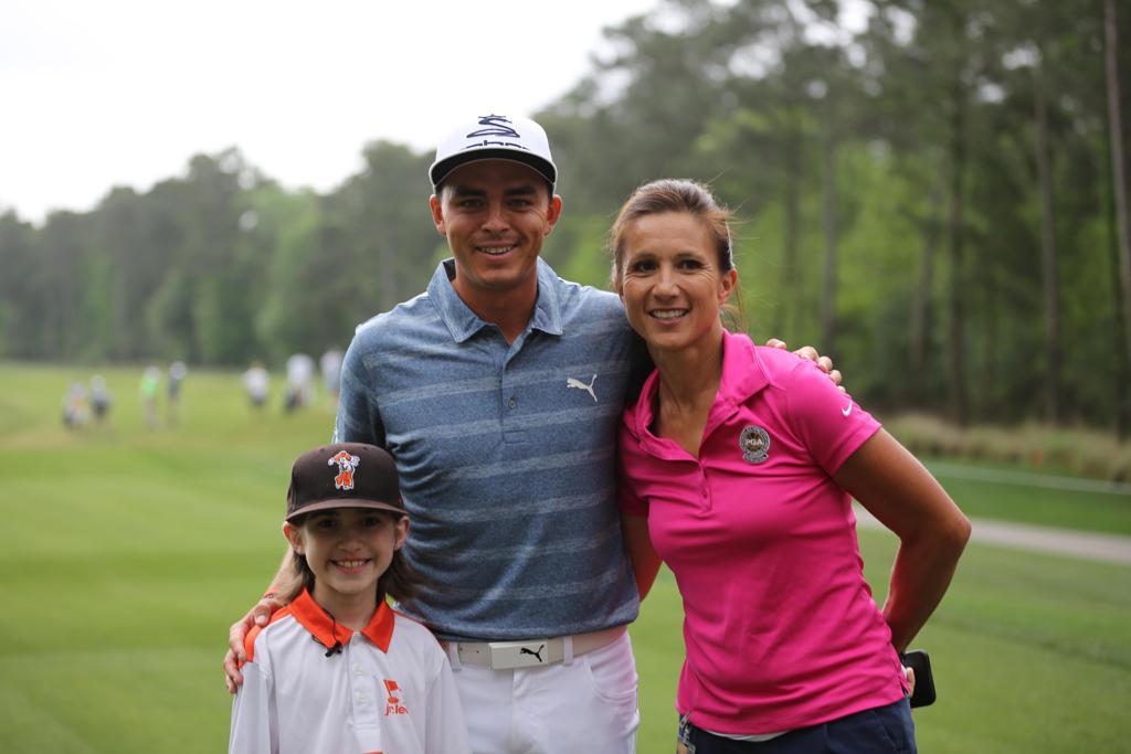 Jhett Skaggs and his PGA Jr. League Captain, Aurora Kirchner-McClain, pose with PGA Jr. League Ambassador Rickie Fowler.