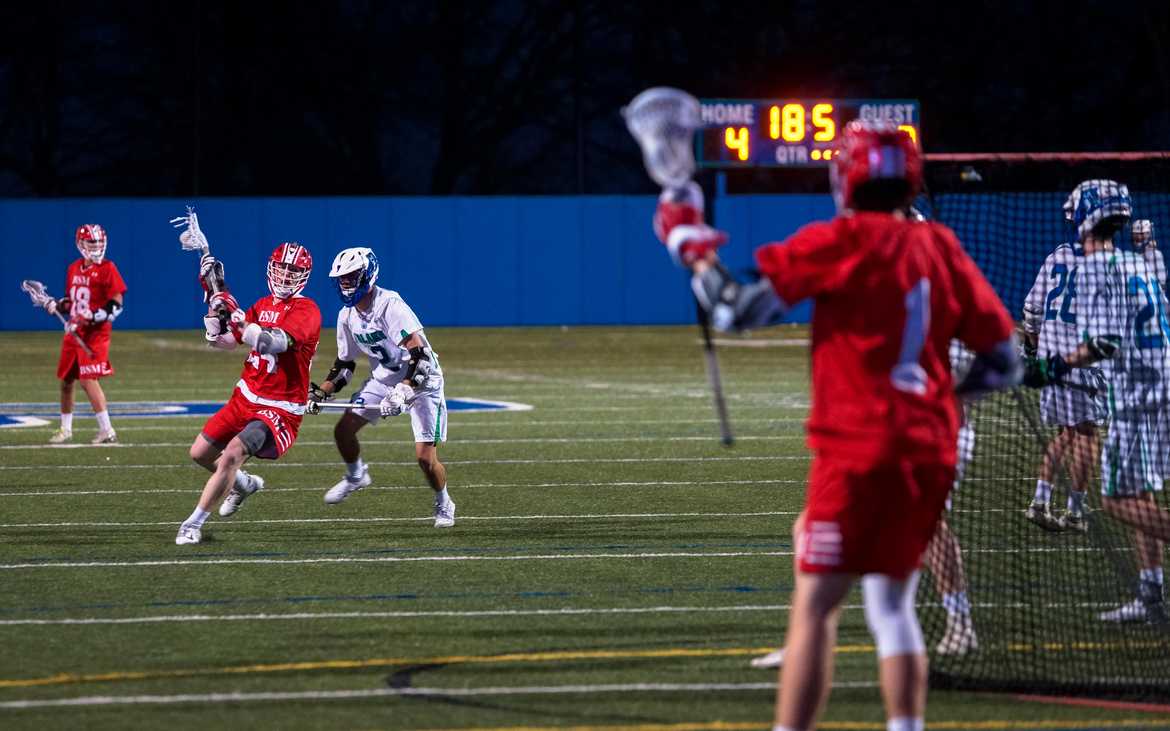 The Red Knights' Quinn Ehlen (red) with one of his two third-quarter goals against Blake in Benilde-St. Margaret's 10-6 win over Blake. Photo by Korey McDermott, SportsEngine
