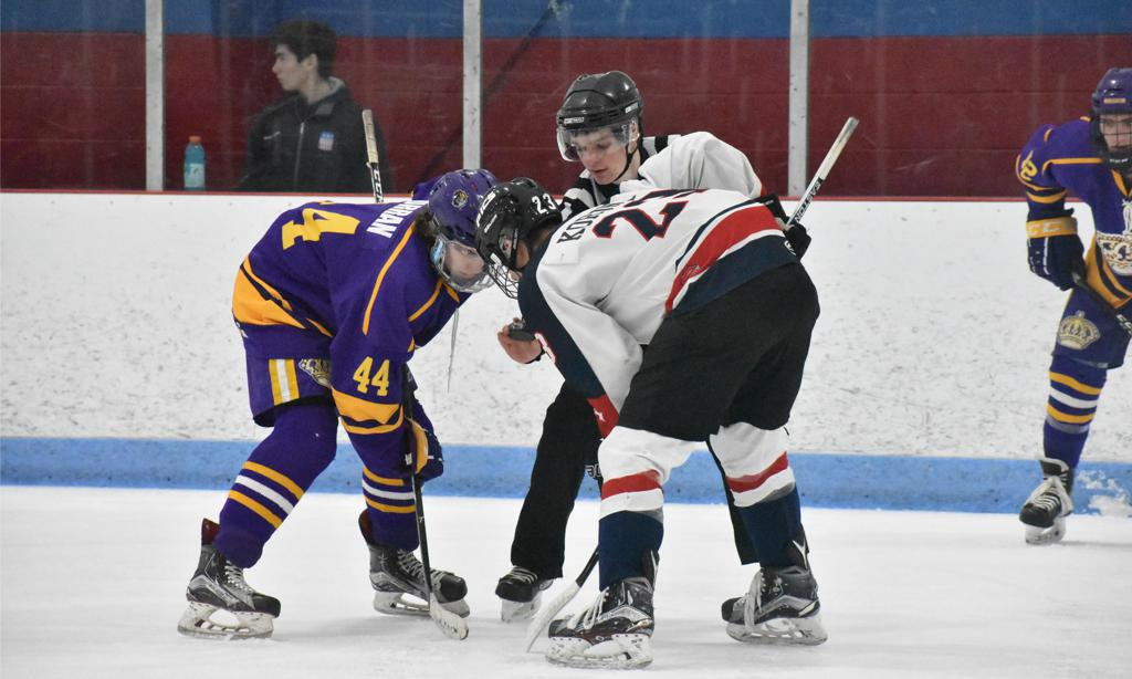 Spencer Korona takes a faceoff vs. the Junior Monarchs