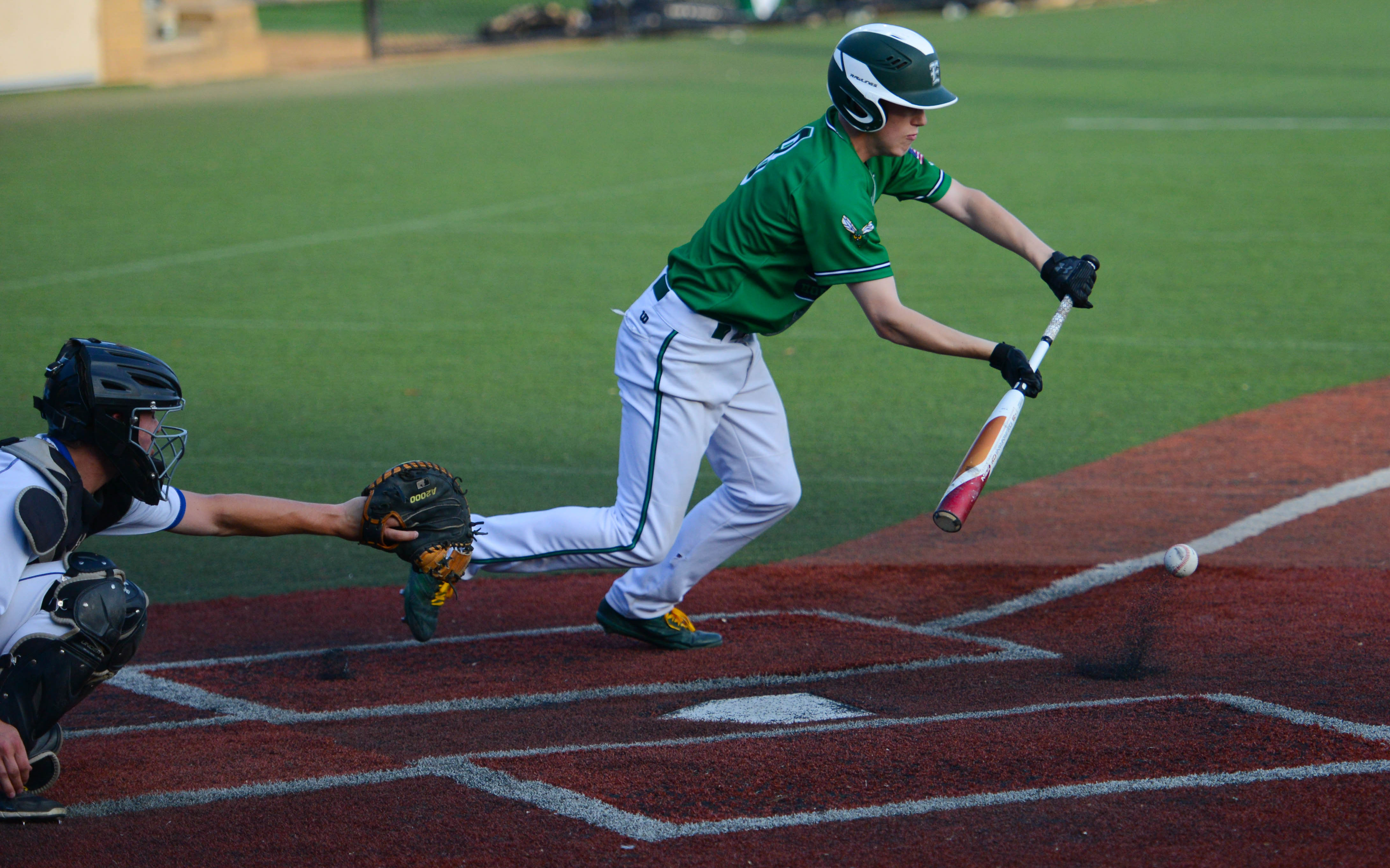 Edina's Andrew Enck lays down a bunt against the Skippers at Minnetonka High School Wednesday night. Photo by Carter Jones, SportsEngine