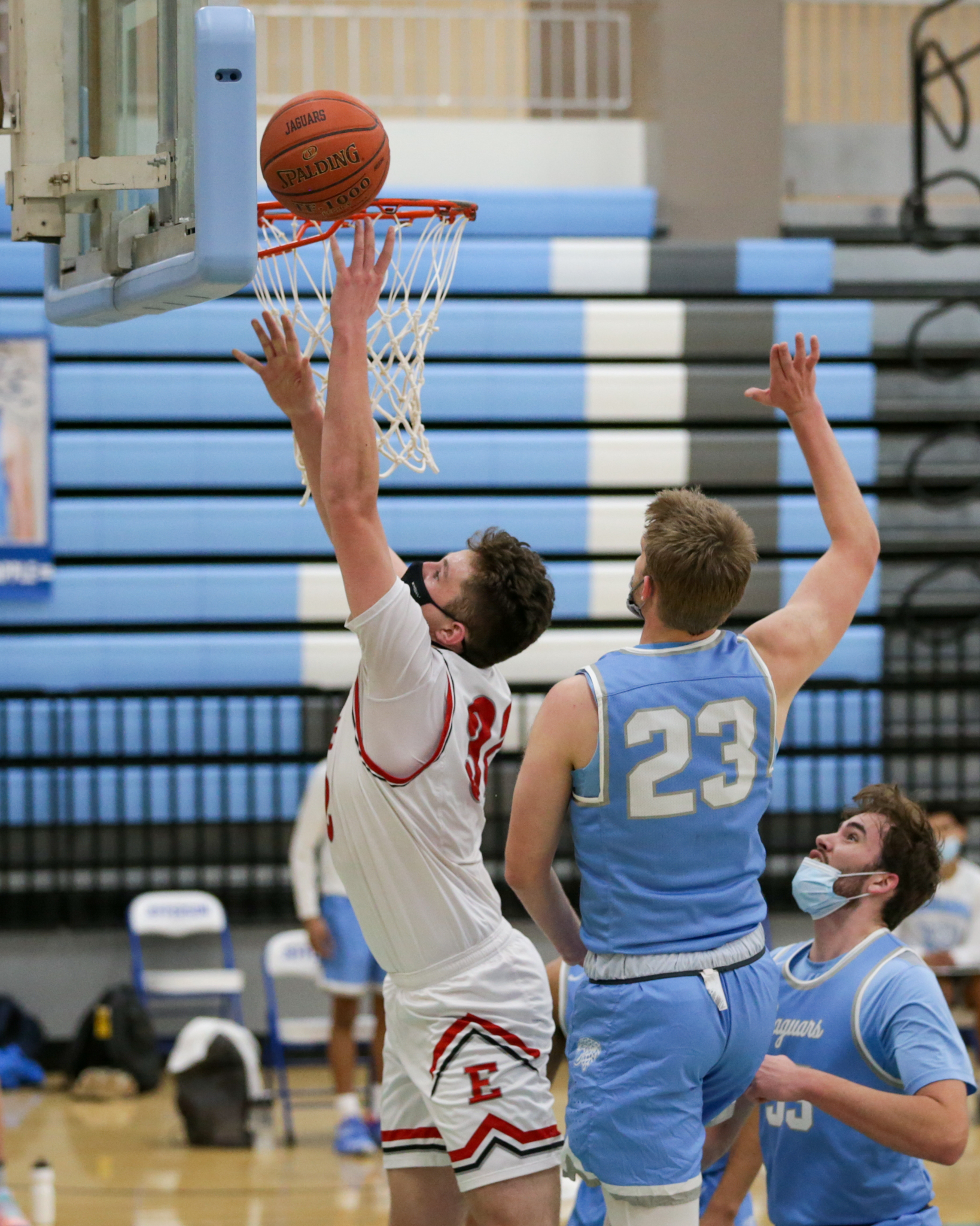 Duluth East's Noah Paulson (32) goes up for two of his 16 first-half points against Bloomington Jefferson Thursday night. Paulson finished with 22 points in the Greyhounds' 63-54 victory over the Jaguars. Photo by Jeff Lawler, SportsEngine