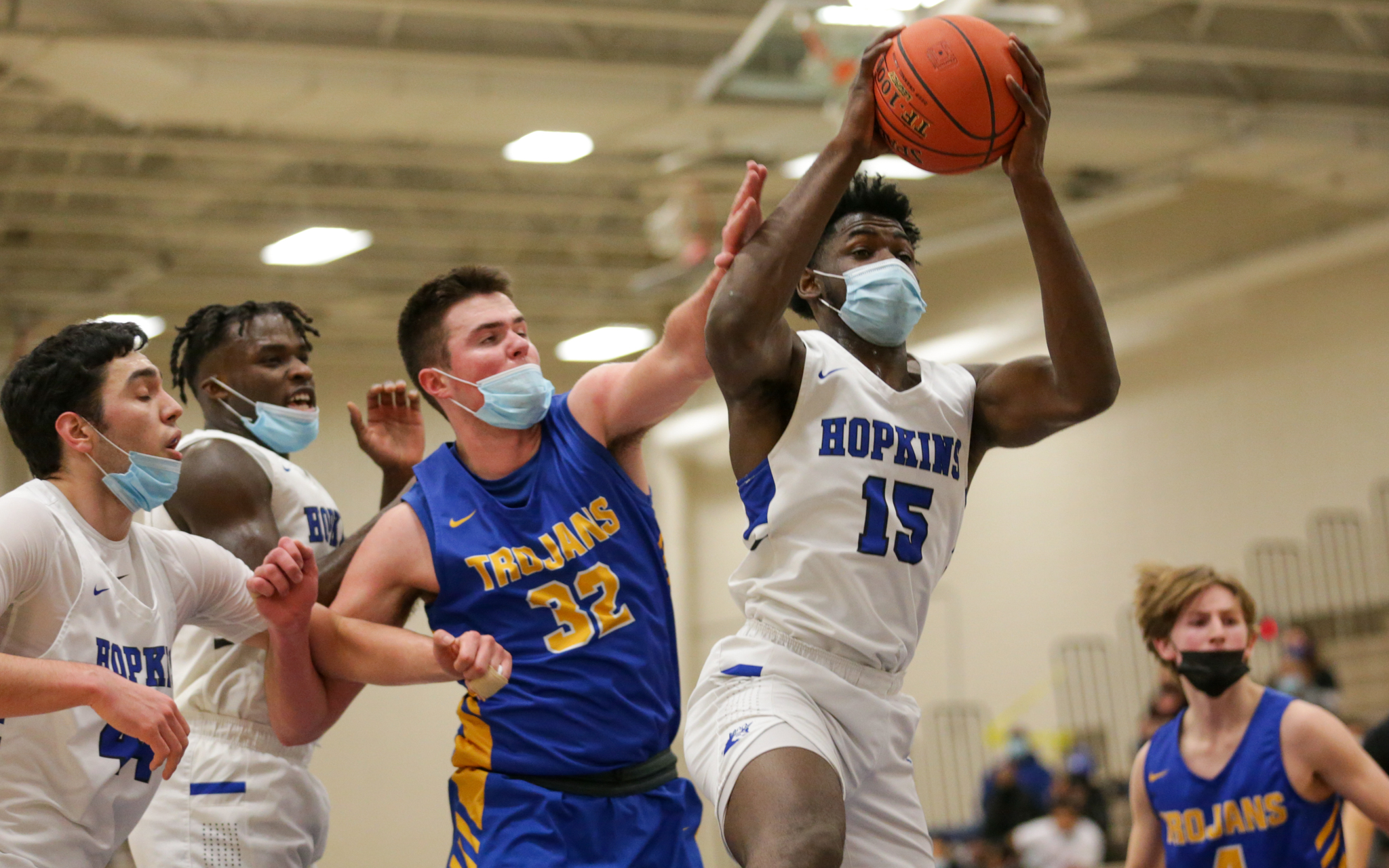 Hopkins' Elvis Nnaji (15) pulls down a rebound against Wayzata in Friday night's Lake Conference game. Nnaji had 13 points in the Royals' 68-60 loss to the Trojans. Photo by Jeff Lawler, SportsEngine