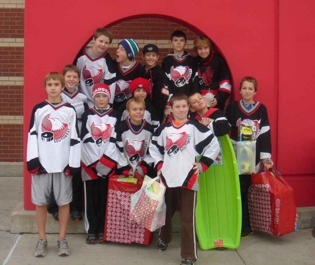2011-12 Southwest PeeWee A team and their families carried on the tradition of helping a family in need over the holiday season