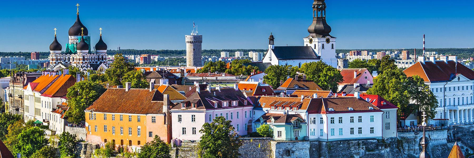 Tallinn's colorful houses next to each other with St. Nicholas church and Alexander Nevsky Cathedral Estonia