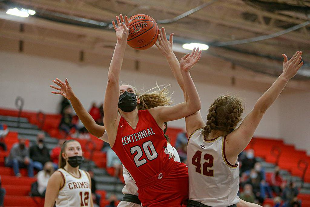 Centennial's Jodi Anderson is fouled by Maple Grove's Sophia Kormann (42) on a drive to the basket. Anderson scored 17 points to lead Centennial. Photo by Mark Hvidsten, SportsEngine