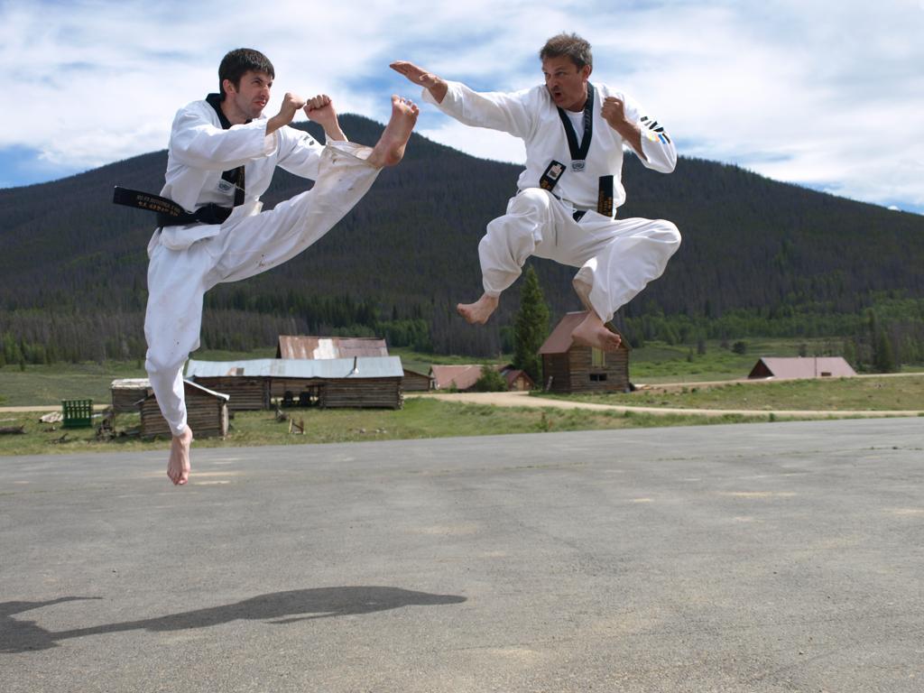 James M. Sautel training with partner