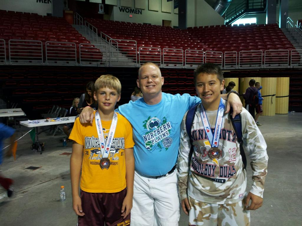 Mason Hall and Lucas Sherburne with Coach Tom Hall