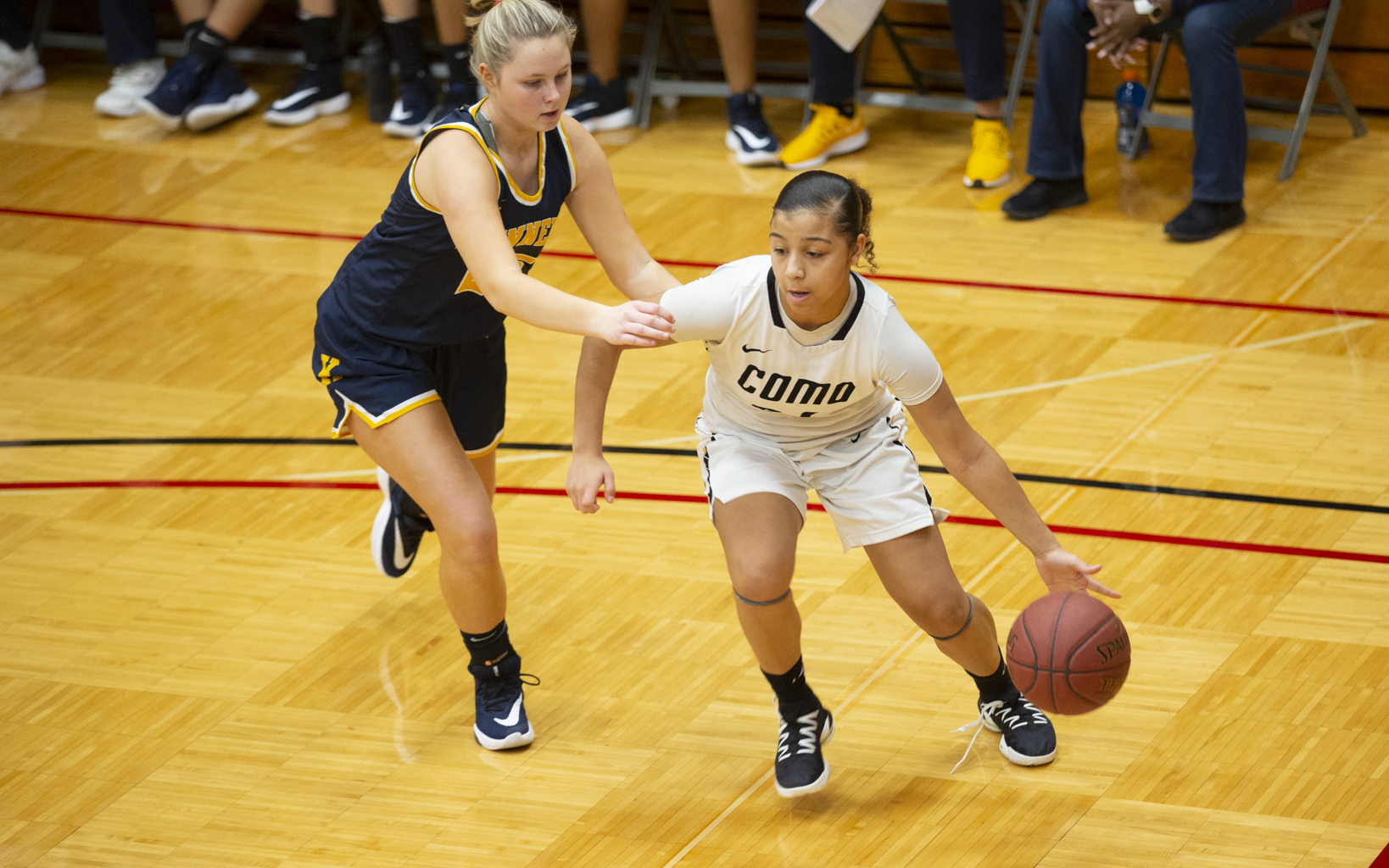 St. Paul Como Park's Kaylynn Asberry (24) drives the baseline around Bloomington Kennedy's Kali Kopka (25) Saturday afternoon at Hamline University.  The Cougars defeated the Eagles 80-40. Photo by Jeff Lawler, SportsEngine