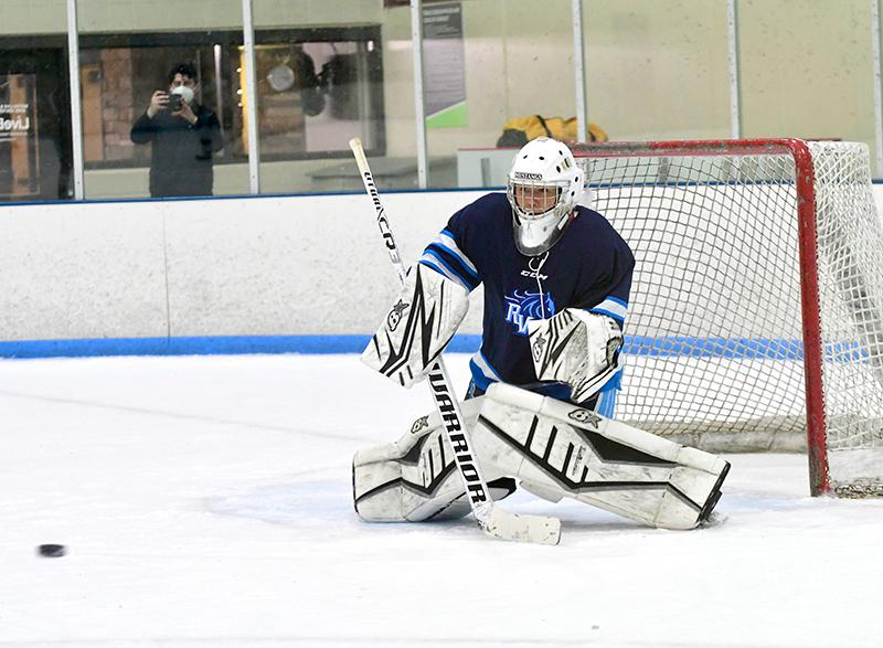 Ralston Valley goaltender Miguel Tanner tracks the puck during the Mustangs' 4-2 victory over Fossil Ridge Saturday. Tanner made 36 saves in the triumph and has yet to lose a game this season. Photo by Steven Robinson, SportsEngine