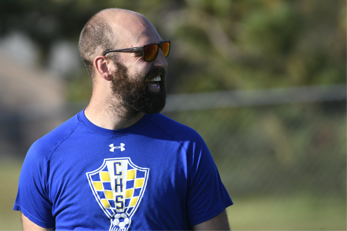 Crusaders coach Alex Hess watches his team practice on Sept. 12 as they prepare for the final stretch of the regular season. Photo by Cole Mayer, SportsEngine
