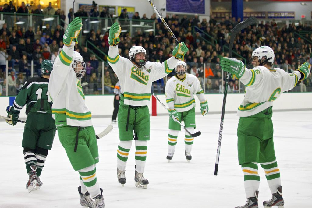 Edina players celebrate a 3rd period goal by Matt Nelson in their victory over Holy Family.  The Hornets broke the game open with a third period scoring binge.  Photo credit - Brian Nelson