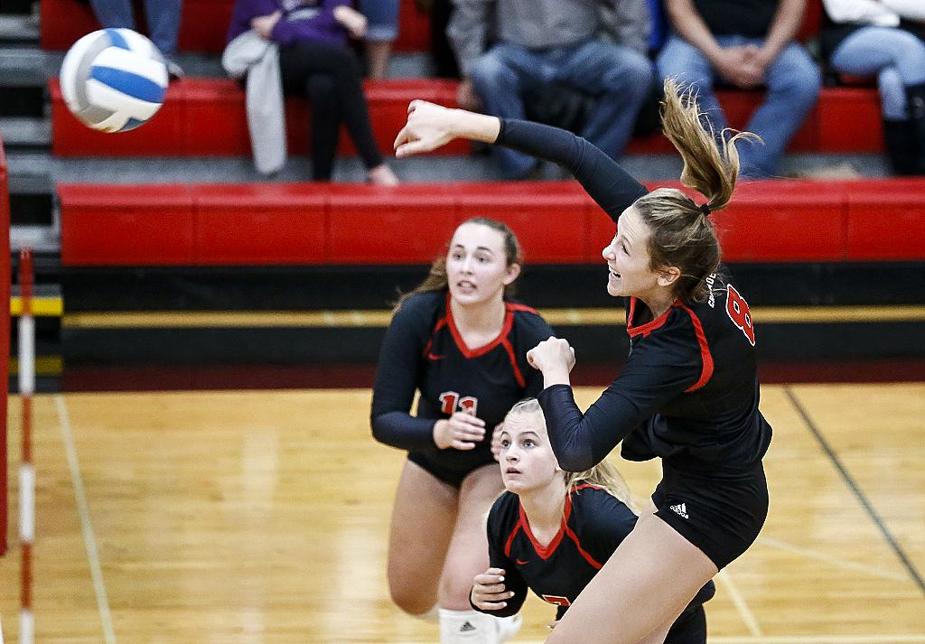Olivia Tjernagel (8) hits one of her 10 kills in the match. Mayer Lutheran fell in three sets to conference rival Southwest Christian. Photo by Cheryl A. Myers, SportsEngine