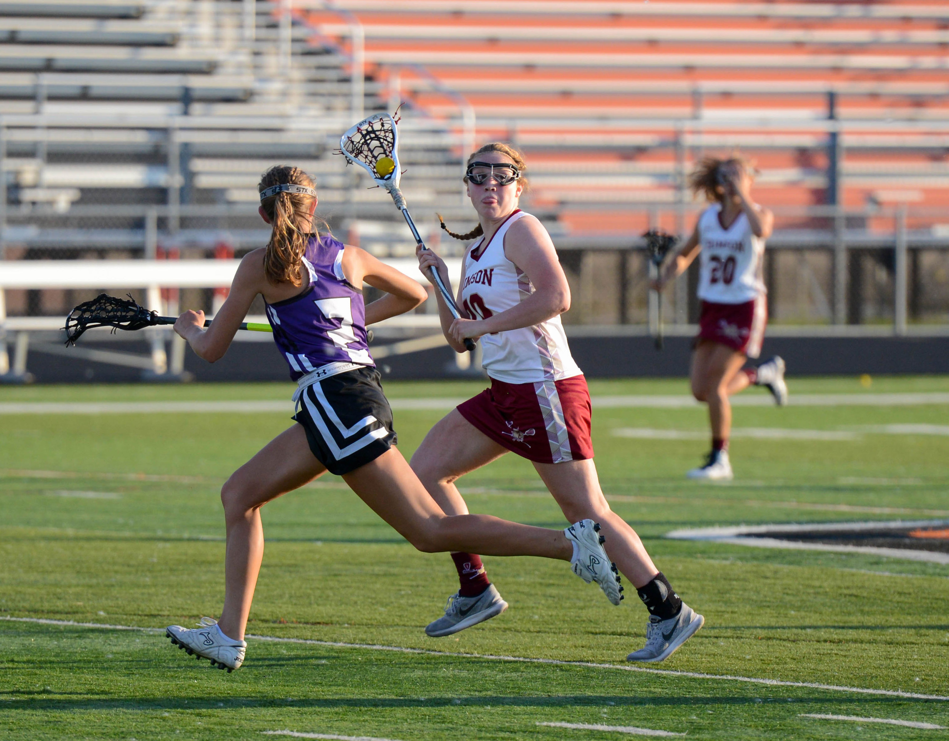 Maple Grove midfielder Emily Herdine (70) passes to a teammate in the Section 8 championship at Osseo High School on Wednesday night. Hardine finished the game with 6 goals. Photo by Carter Jones, SportsEngine
