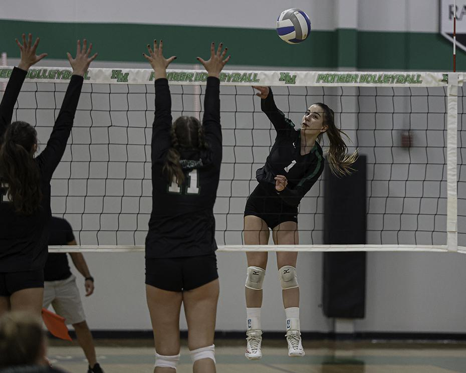 Concordia Academy senior Gia Waters (1) attacks during the Beacons' 3-0 victory Tuesday night at Hill-Murray. Waters' 14 kills led the way for Concordia Academy. Photo by Mark Hvidsten, SportsEngine