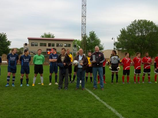 Madison 56ers and SV Blau-Weiss Wiehre Freiburg at midfield before Saturday's friendly