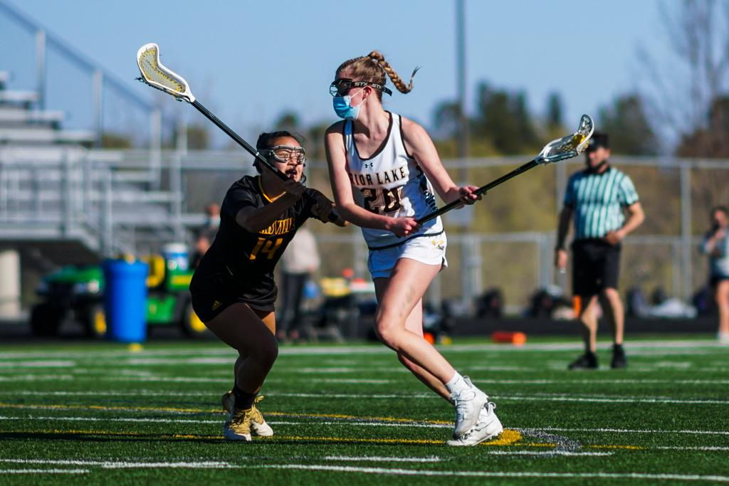 Payton Bloedow engages a defender in an April 29 game. Photo by Korey McDermott, SportsEngine