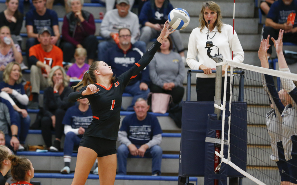 Osseo's Lindy Oujiri (1) taps the ball at the net against Champlin Park Tuesday night. The Orioles fell in straight sets to the Rebels in a Northwest Suburban Conference match at Champlin Park High School. Photo by Jeff Lawler, SportsEngine
