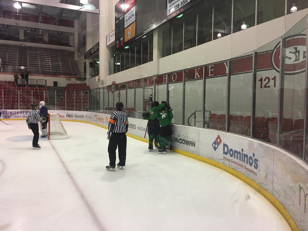 Team Green celebrates a goal in the first half against Team Royal.