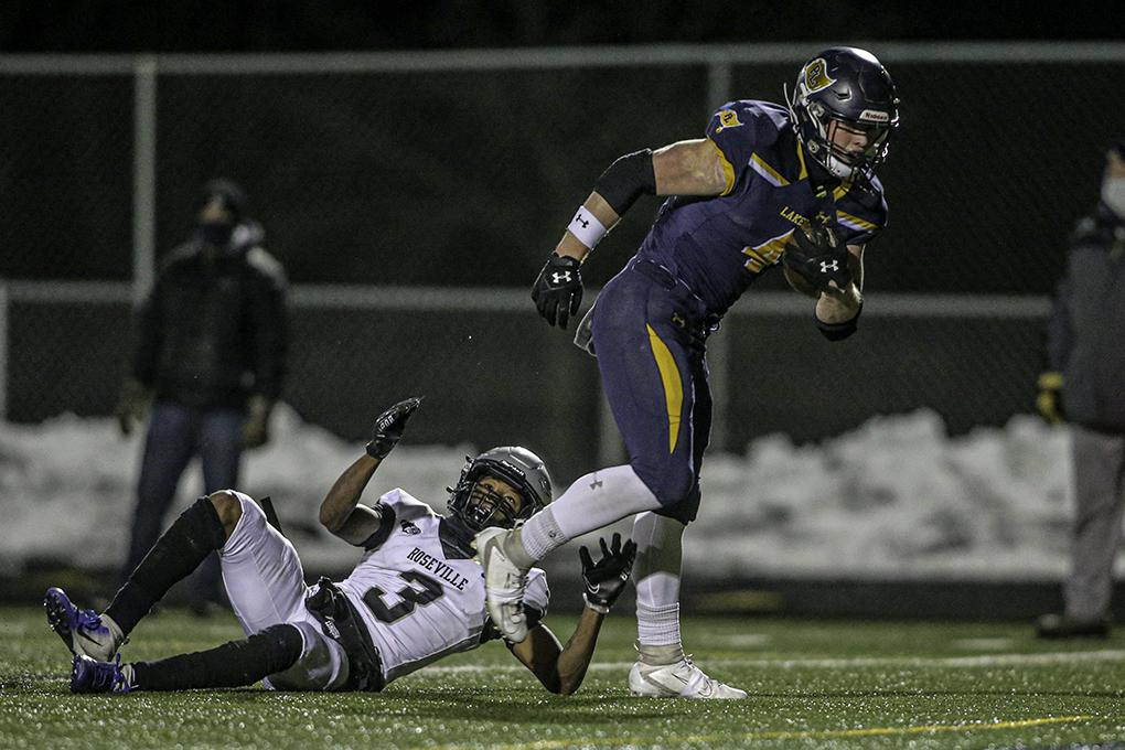 Prior Lake's Cameron Miller ran over Roseville's Teris Watson (3) on his way to the game's first touchdown. Photo by Mark Hvidsten, SportsEngine