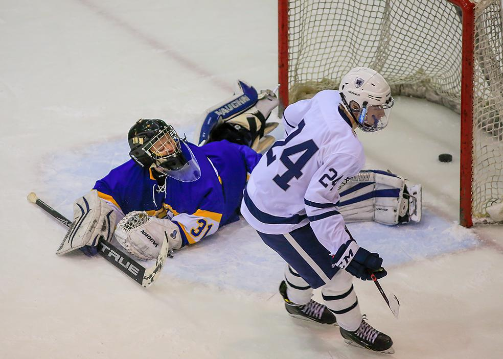 Hudson defensman Carter Maack's shootout goal against St. Michael-Albertville goaltender Blake Marhula was the difference in winning the tournament after finishing overtime tied 3-3. Photo by Mark Hvidsten, SportsEngine