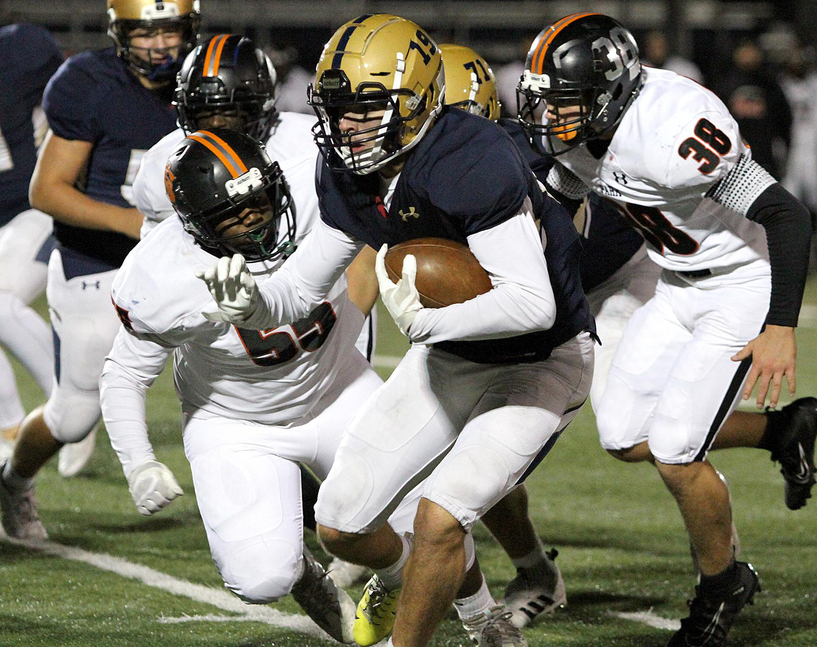 Chanhassen junior Jason Collins finished with 132 yards on 31 carries to help lead the Storm to a 40-24 win over St. Louis Park on Friday. Photo by Drew Herron, SportsEngine