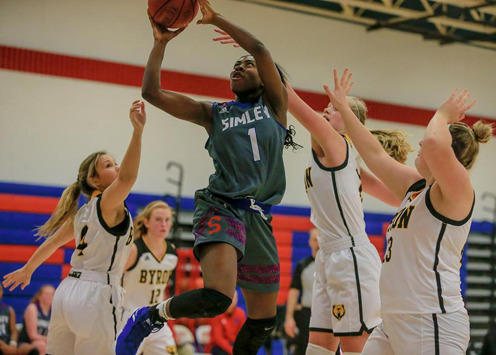 Simley's Tiwaah Danso (1) got past a trio of Byron defenders on her way to two of her 19 points. Photo by Mark Hvidsten, SportsEngine